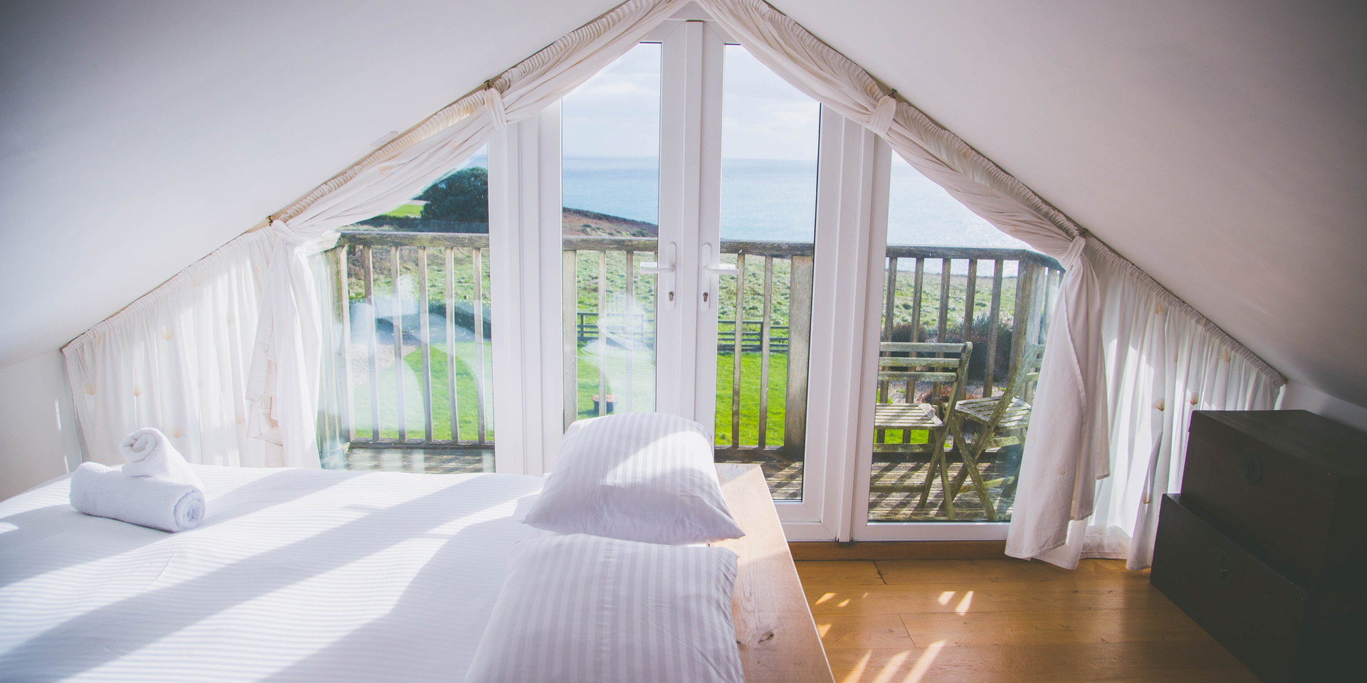 Master bedroom with view of sea