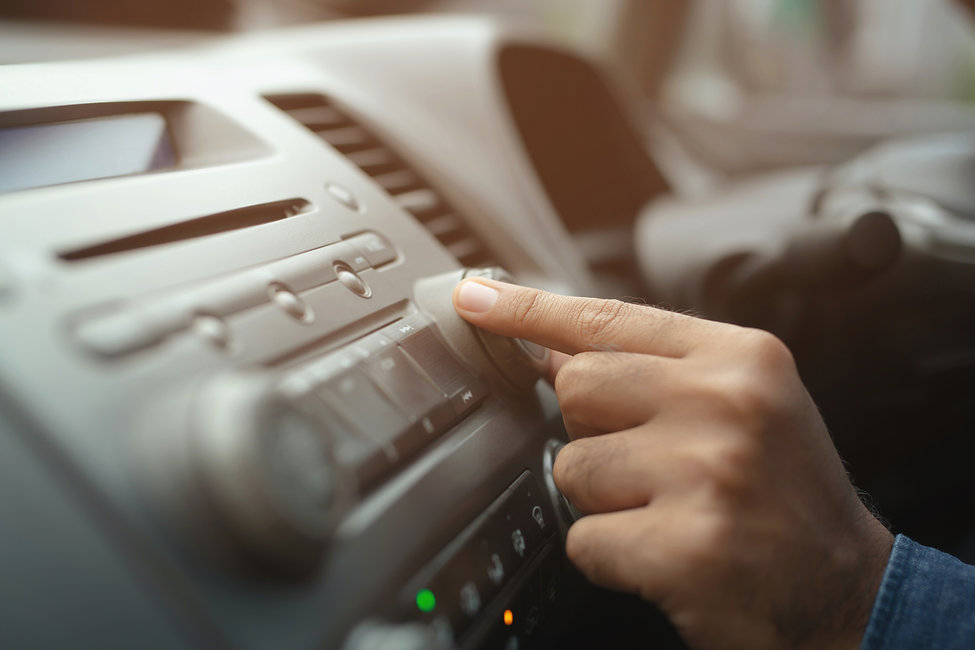 close up hand open car radio listening. Car Driver changing turning button Radio Stations