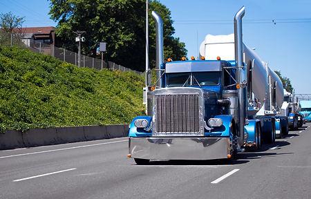 Bonneted big rig convoy.jpg