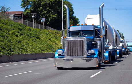 Bonneted big rig convoy.jpg