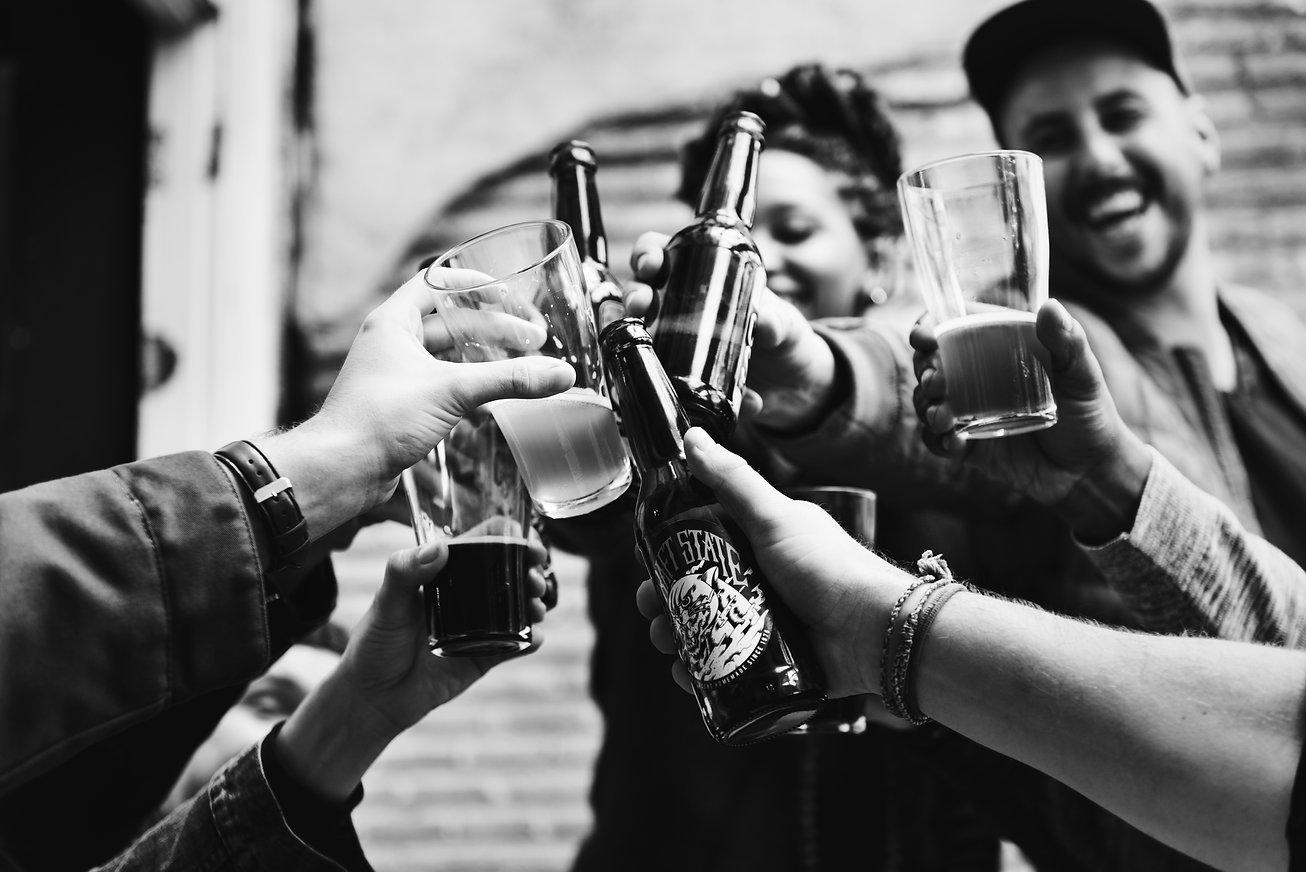 people-making-toast-with-beers.jpg