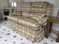 Upholstery of a sofa with mechanical
