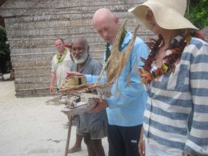 hn and Elena Kearney received model TePuke from Chief Moses Memuana. Expedition leader Nathan Russ in background