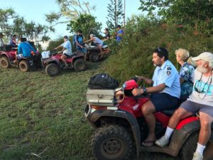 crew being carried around on 4-wheelers. Steve and Cheryl of Gershon II sit behind David, the Policeman