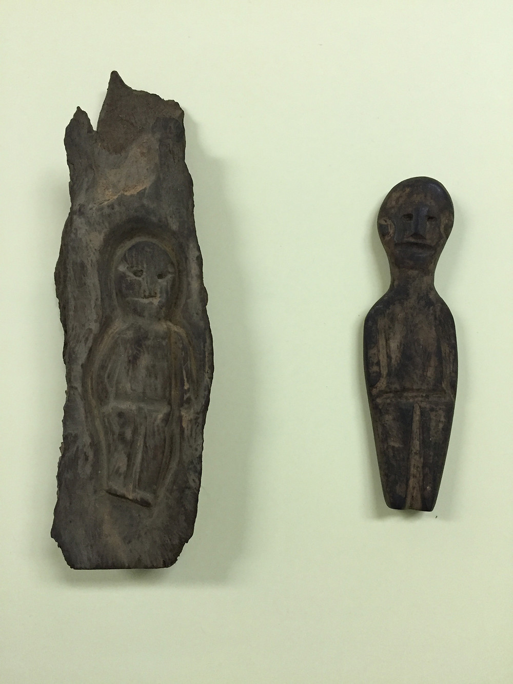 Carved figures from a Guantanamo cave