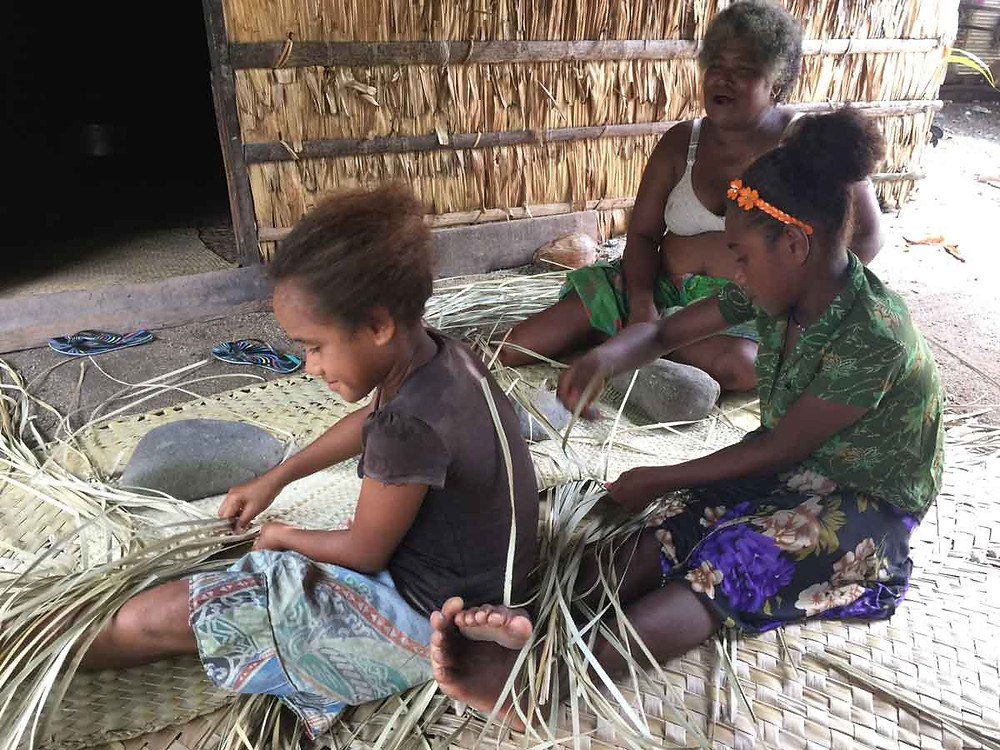 Auntie helps girls learn to weave sail