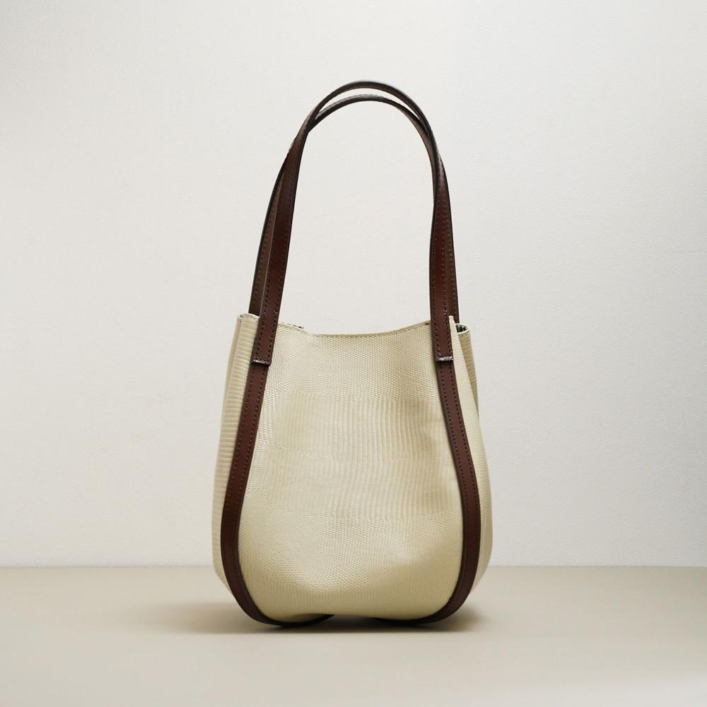 Lizard embossed leather beige hand bag