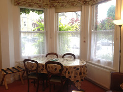 Dining table and windows to front