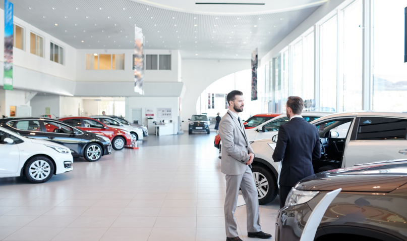 men at car dealership - f&i.PNG