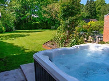 Relax in the hot tub at Rosehill Manor