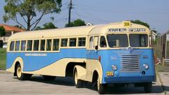 WHITE SEMI-TRAILER BUS
