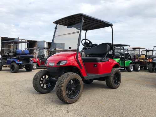 2014 E-Z-GO TXT REVAMP GAS Flame Red on red ezgo golf cart, lifted ezgo golf cart, lifted yamaha golf cart, car wheels on lifted golf cart, red chevy golf cart, red dot enclosures golf cart, red golf cart illustration, red jack up golf carts, red custom golf cart, super lifted golf cart,