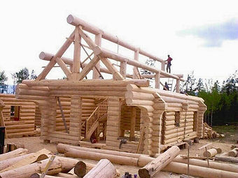 Large log cabin being constrcted log by log