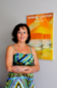 I am Tatyana standing in my cozy home Office next to Germaine De Capuccini Royal Jelly Poster