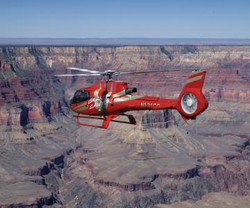 RS8592_GCH_RedHeli_PS-flying-through-gra