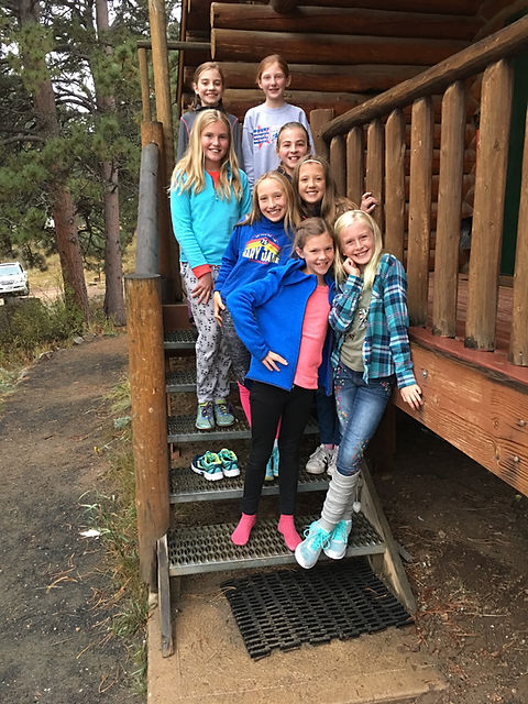 Students outside cabin (girls).jpg