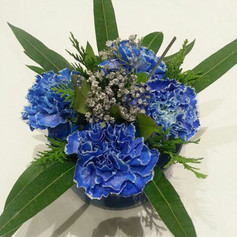 4 Carnation and Greens Centerpiece