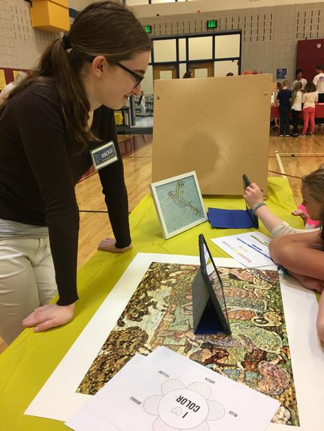 teacher observes art student