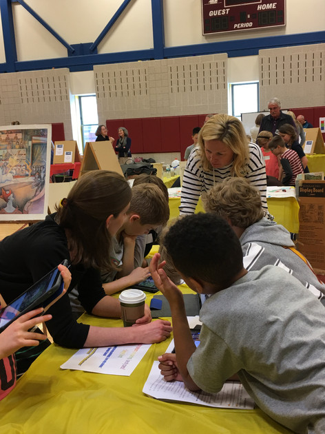 students collaborate with teacher on