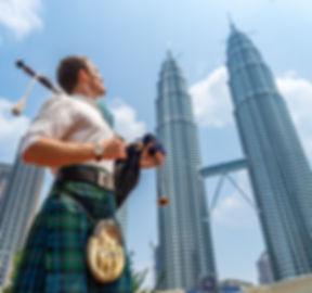 Bagpipes and Kilt at Petronas Towers Kuala Lumpur