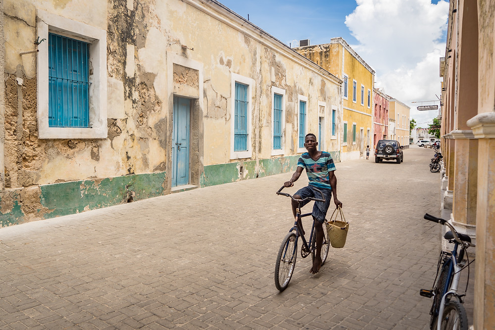 Man cycling down main road on Ilha