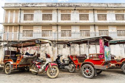 Tuk-tuks at Tuol Sleng