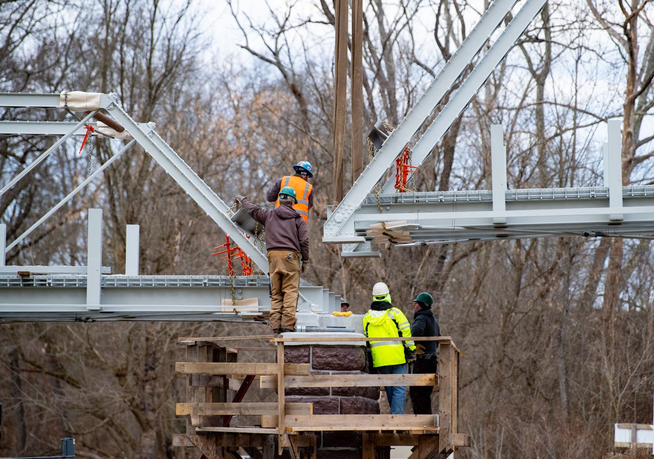 Crews guided the truss into place on its foundation