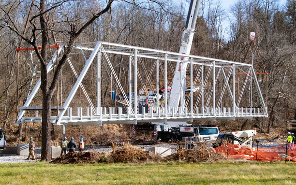 Cranes lifted the truss off the ground