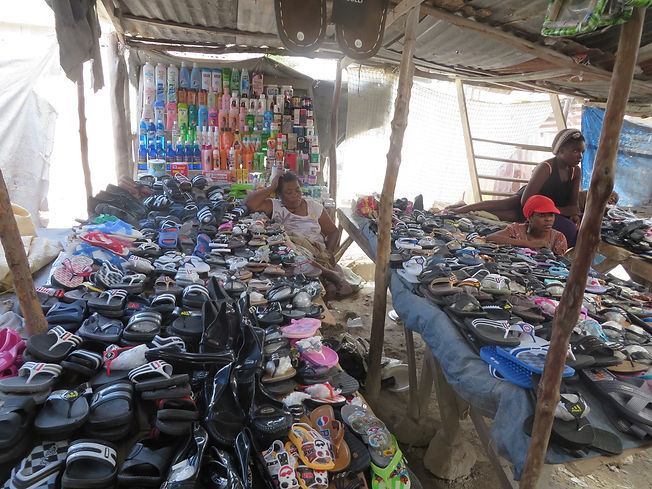 Lots if shoes at market.jpg