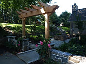 flagstone patio and arbor - Jim Heller Assoc.