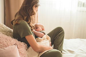 The concept of breastfeeding. Portrait o