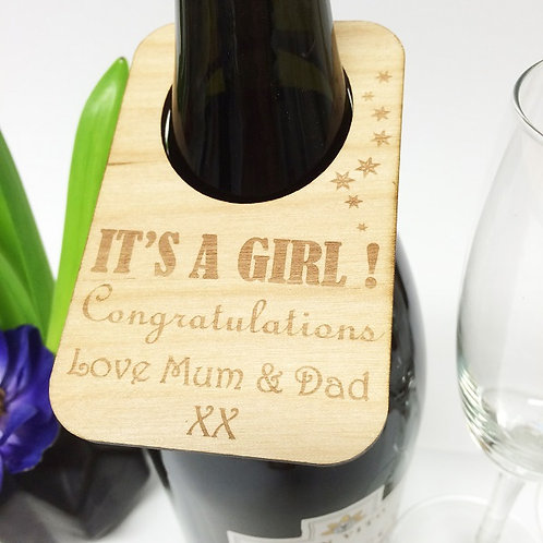 Personalised wine bottle label celebrating the birth of a girl.