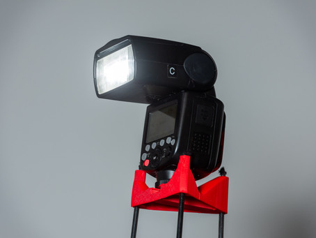 Tent pole light stand