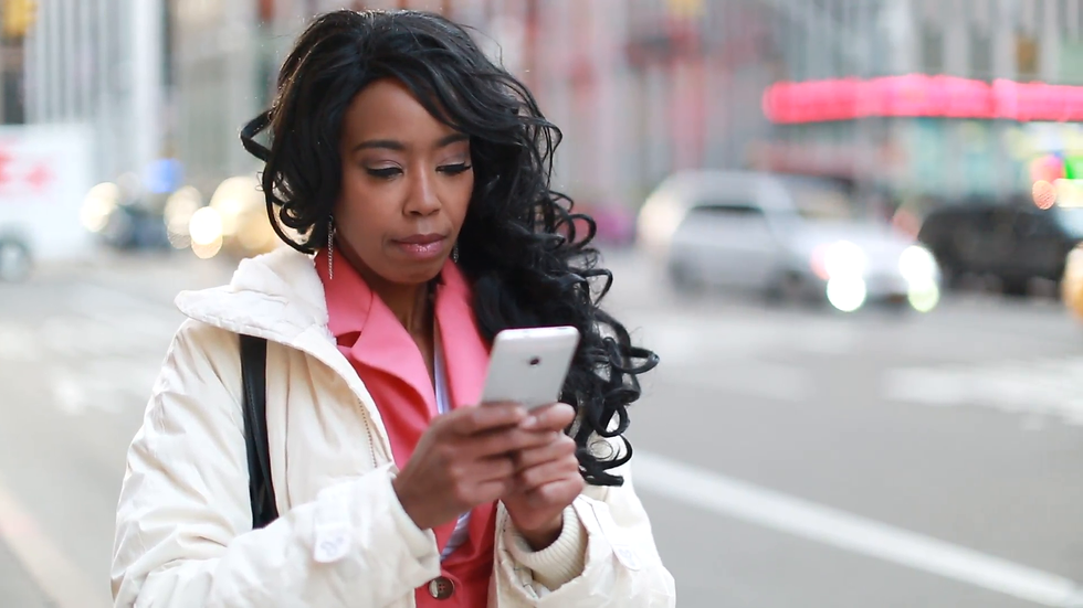 black woman on phone 1.png