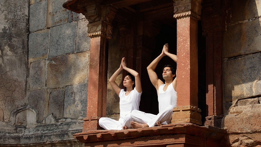 Couple Meditating in Temple
