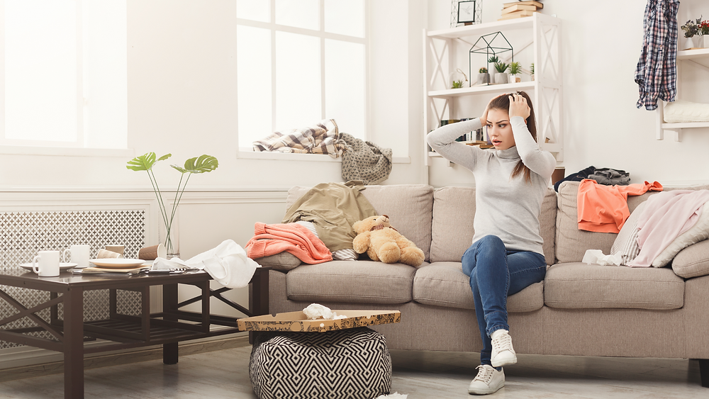 Woman ooverwhelmed in messy living room