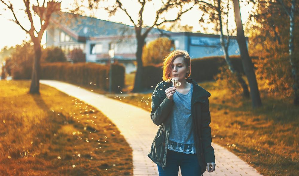 Girl Blowing Weeds Optimism