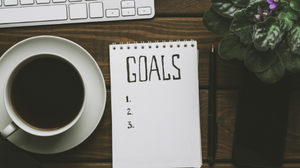 Goal List With Coffee on Desk
