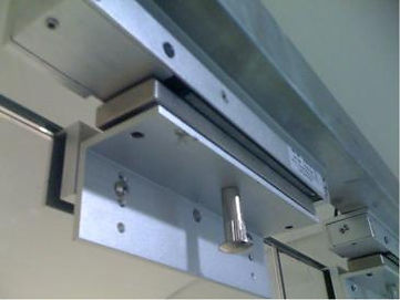 Magnetic lock and brackets for doors