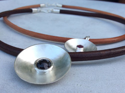 Cupped Sapphire On Leather Cord