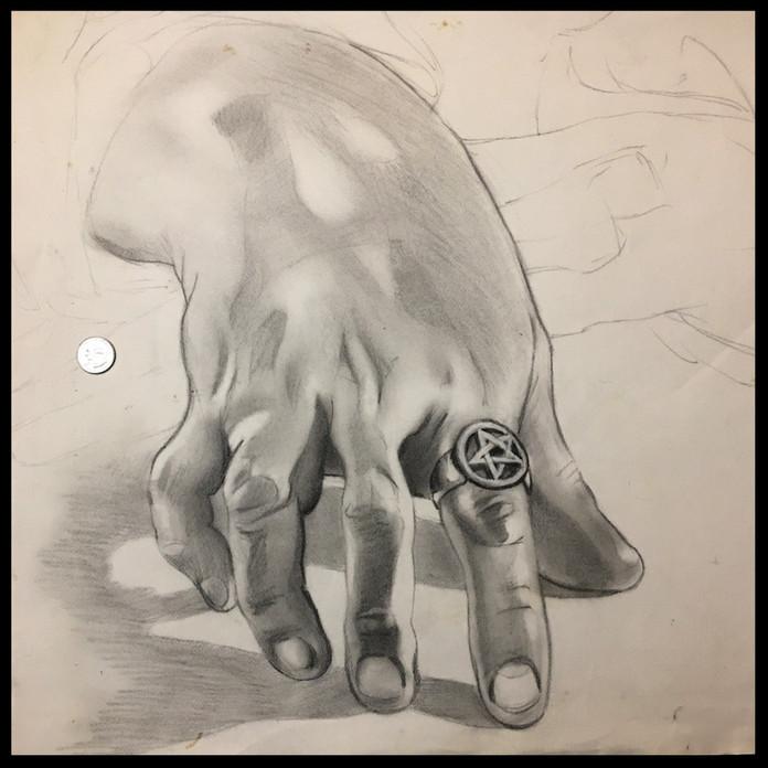 Hand (pencil-- quarter for scale)