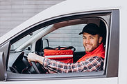food-delivery-man-driving-food-box.jpg