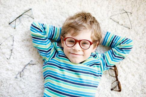 Close-up portrait of little blond kid bo