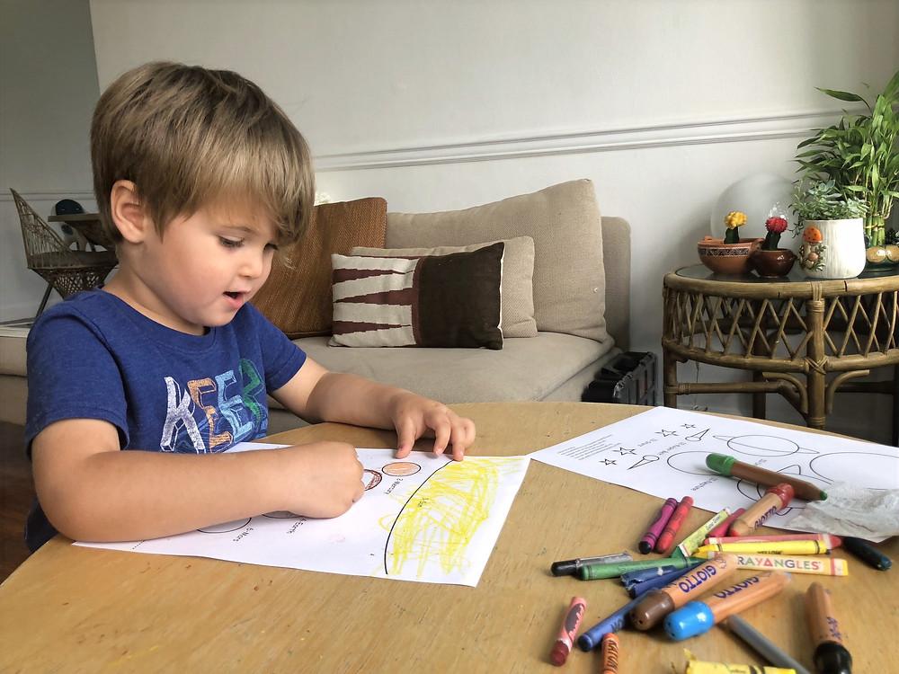child coloring in homeschool