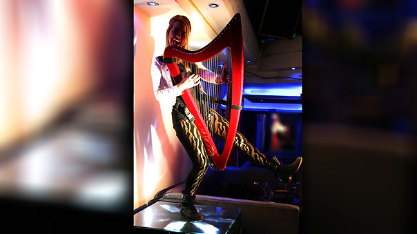 Kiki Bello_Electro Harpist For Hire Corp