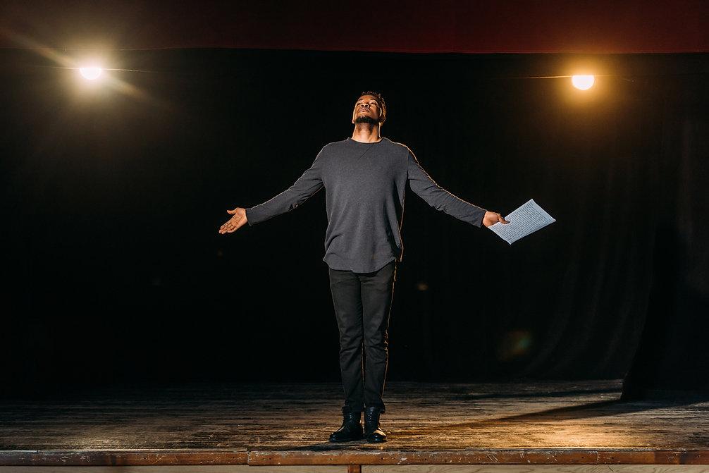 african american actor holding scenario