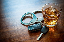 Whiskey with car keys and handcuffs conc