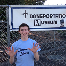 Museum Director Andrew Mancini stands outside the 10th Annual Transportation Museum in San Carlos, CA, after a successful museum.