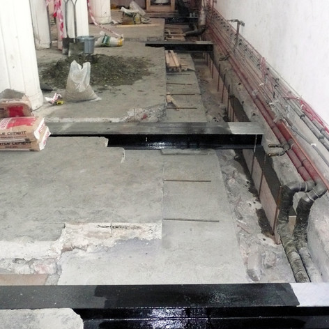 Reinforcing floor structure with steel beams