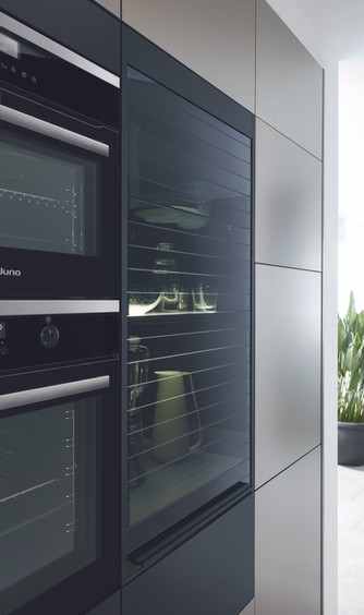 Schuller_kitchen_black_glass_tambour_uni
